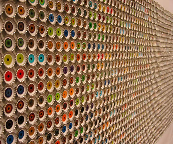 Frame them: they will look so pretty on a kitchen wall for instance. & Re-using bottle caps as decorative pieces.   Homafrica