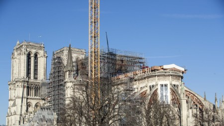 Workers dismantle the scaffolding on the