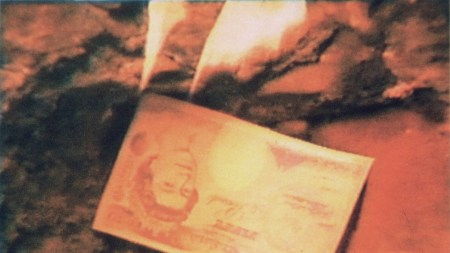 A £50 note on fire as