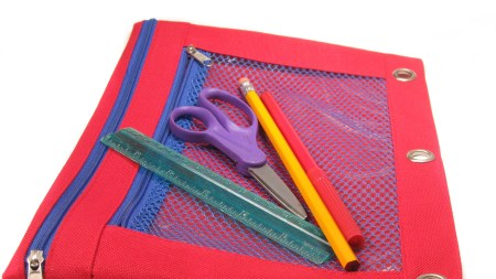 Red canvas carrier for school supplies