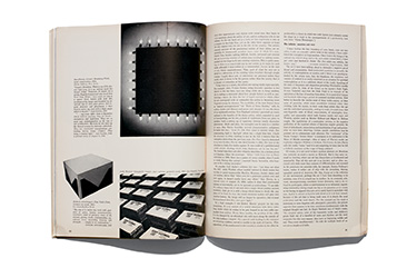 A magazine spread with black and white images of works by Dan Flavin and others
