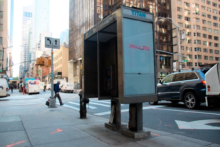 """A phone booth in New York featuring Glenn Ligon's 'Aftermath,' which figured in the exhibition """"TITAN."""""""