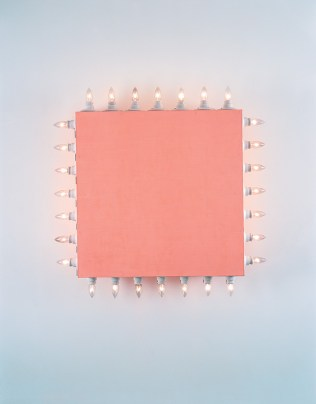 A wall mounted sculpture consisting of a red masonite square lined with candle-shaped electric lights