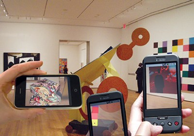 Phone screens show digital renderings of artworks projected into the galleries of New York's Museum of Modern Art