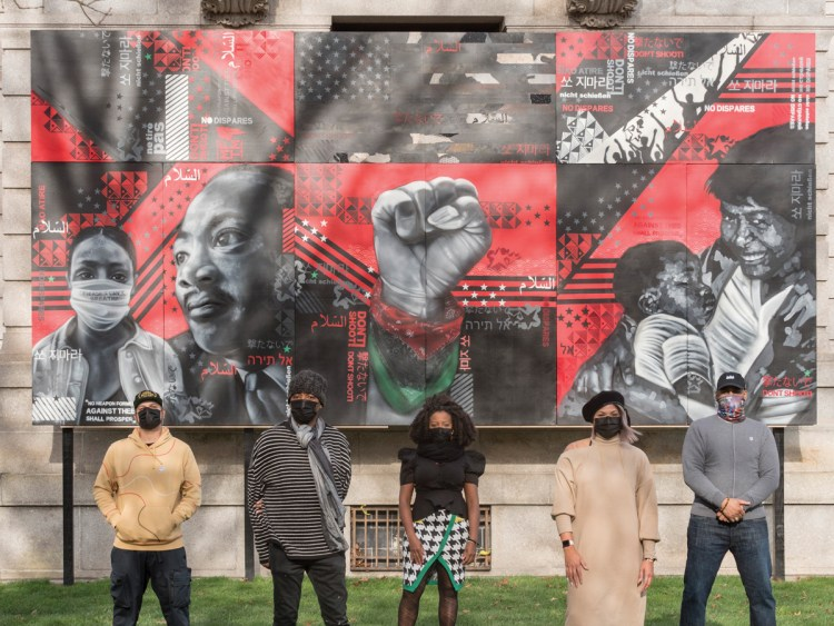 "Artists stand by their work for the Murals for the Movement project in front of MFA Boston, from left to right: Victor ""Marka27"" Quiñonez, Cey Adams, Sophia Dawson, Liza Quiñonez, and Rob Stull."