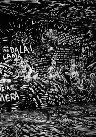 The walls, floor, and ceiling of a black room are covered with ghostly writings and drawings in chalk