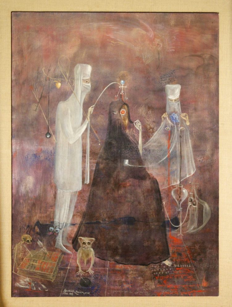 A member of staff poses with 'Operation Wednesday', by British-born Mexican surrealist artist Leonora Carrington, estimated at GBP300,000-500,000, during a press preview for the upcoming 20/21 Century Week sale at Bonhams auction house in London, England, on March 22, 2021. The sale takes place later this week, on 24-25 March. (Photo by David Cliff/NurPhoto via AP)