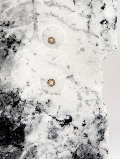 black and white marble with two colored contact lenses on top
