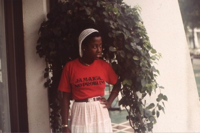 Vintage color photo of a Black woman wearing a red tshirt reading Jamaica, No Problem