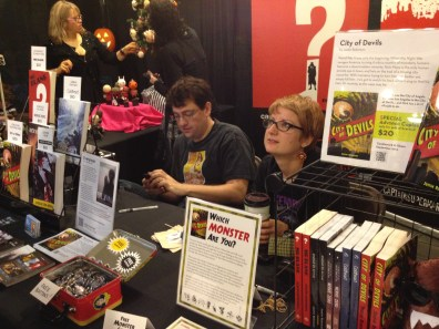 "Justin Robinson's booth and his new book ""City of Devils""!"