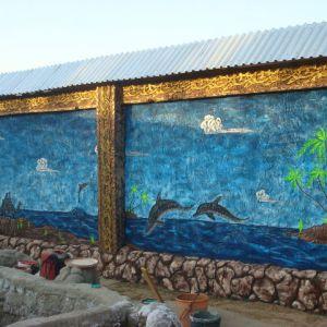 Барельеф из бетона Дельфины