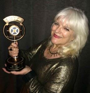 Karena with her Bronze Trophy from New York Festival's World's Best Radio Programs.