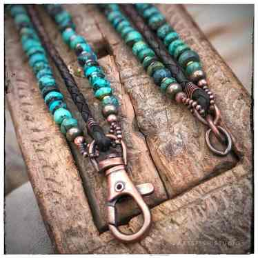 Clasp detail of copper with turquoise and leather bracelets.