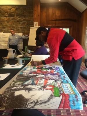 Ariston Jacks, an Alternate ROOTS Member, sketching  during ROOTS Innovation Team meetings.