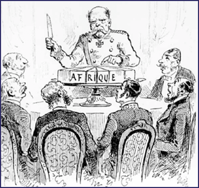 "Six men look on as a seventh man carves up a cake that reads ""Afrique"" on the side"