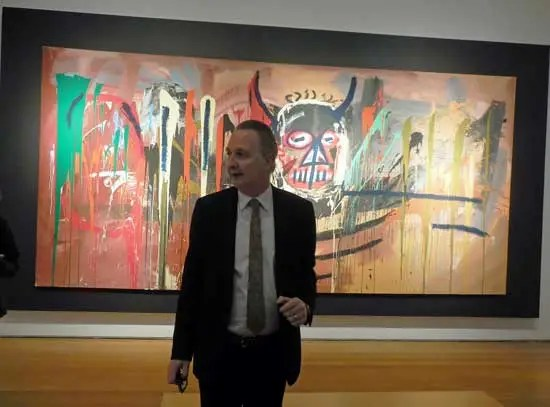 Brett Gorvy in front of the $57.29-million Basquiat Photo by Lee Rosenbaum