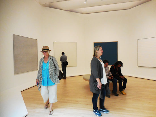 Happy visitors to octagonal Agnes Martin gallery (a highlight of the Fisher display) Photo by Lee Rosenbaum