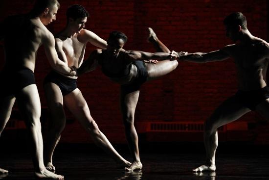 L-R: Nicholas Sciscione, Joshua Tuason, and Joshua Green support Davalois Fearon. Photo: Julieta Cervantes