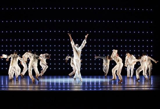 Alvin Ailey American Dance Theater in Robert Battle's Awakening, Jamar Roberts center. Photo: Paul Kolnik