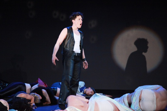Jules Skloot sings among the fallen. Photo: Theo Cote
