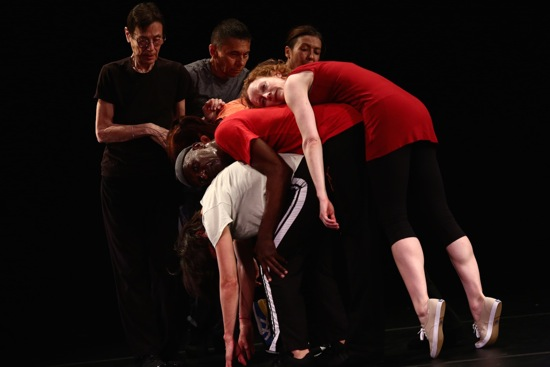 Yvonne Rainer's The Concept of Dust: Continuous Project—Altered Annually. (L to R) back row: Yvonne Rainer, Keith Sabado, Emmanuèle Phuon; pileup: Patricia Hoffbauer, David Thomson, Pat Catterson, and Emily Coates. Photo: Paula Court