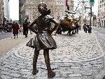 Why A Bronze Statue Of A Girl Is Standing In Front Of Wall Street's Rampaging Bull