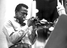 Miles Davis facing right