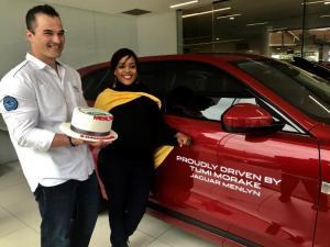 Tumi Morake being presented with her new Jaguar F-PACE by Eric Vorster, Dealer Prinicipal at Jaguar Land Rover Menlyn.