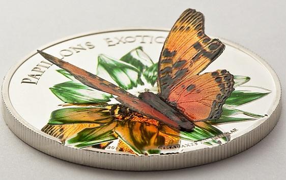 Камерун, серебряные 1000 франков, а бабочка на них - с трепещущими крылышками