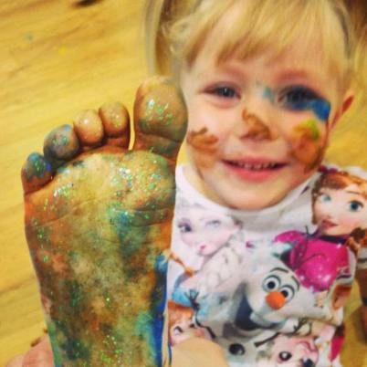 Happy child with paint on feet