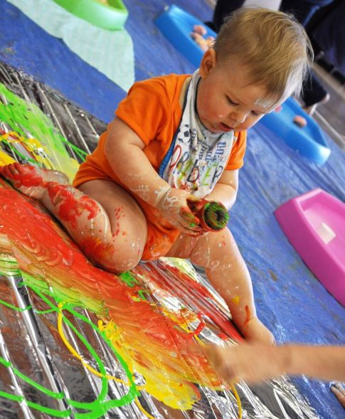Baby playing with paint