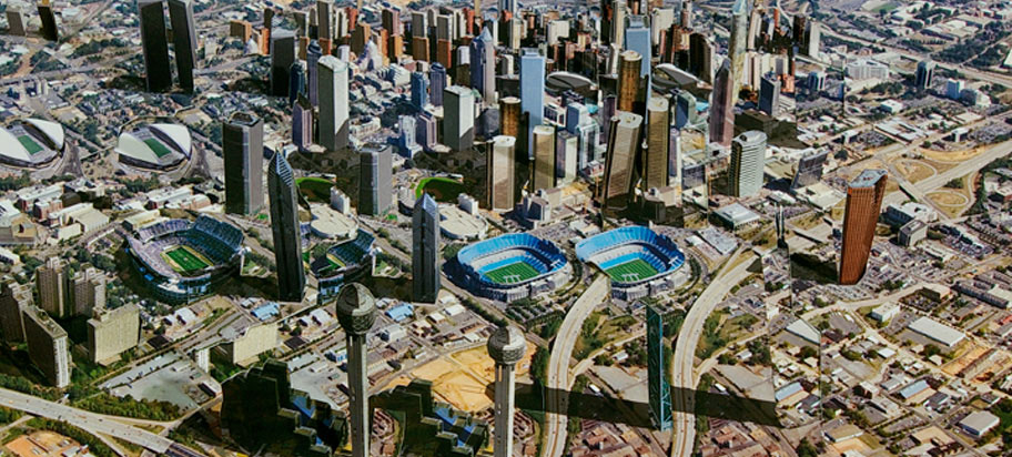 aerial view of city featuring stadiums and skyscrapers