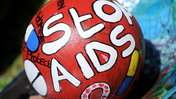 "painted oware ball with ""Stop AIDS"" written on it"