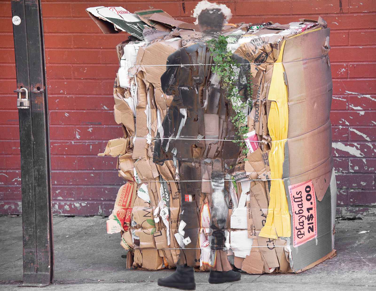 man in front of stack of cardboard boxes