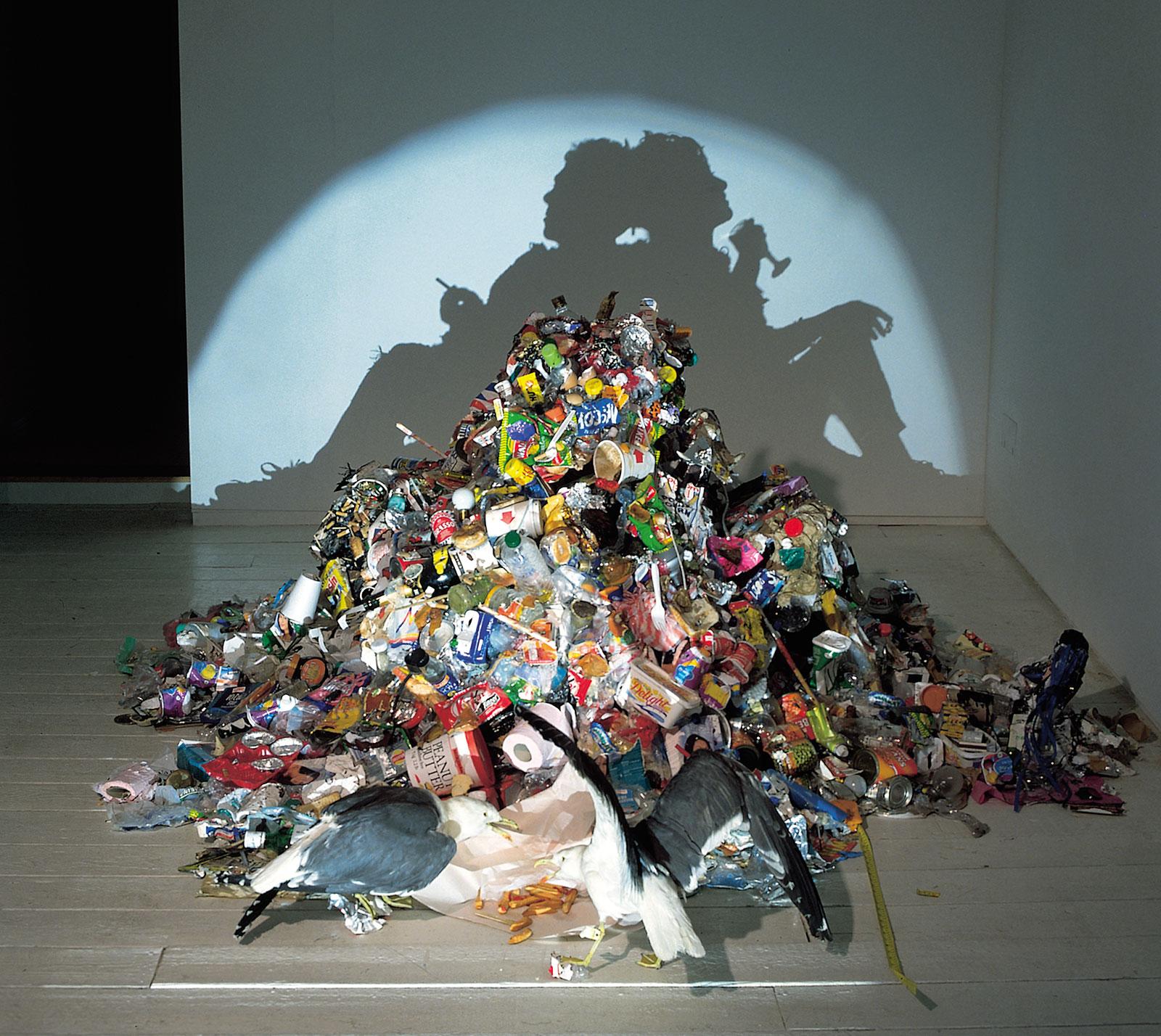 figurative shadow art from trash