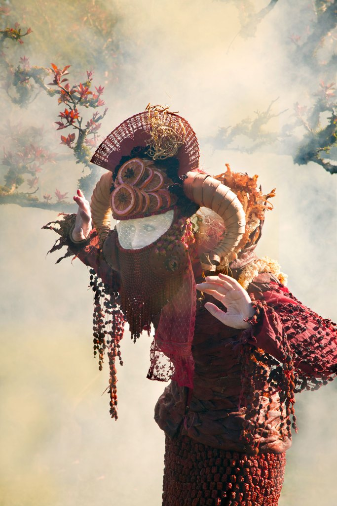 woman in red costume with smoke