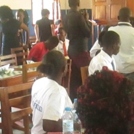 Ugandan World chess player visits ARU, over 100 students and staff trained