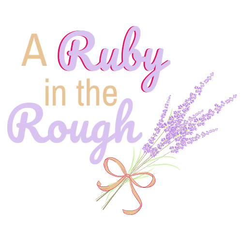 The Logo is lavender and tan and says A Ruby in the Rough and has a bouquet of lavender with a ribbon tied around it.