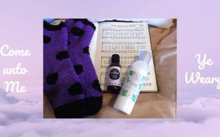 Picture of open hymn book, fuzzy socks, lavender, and foot cream