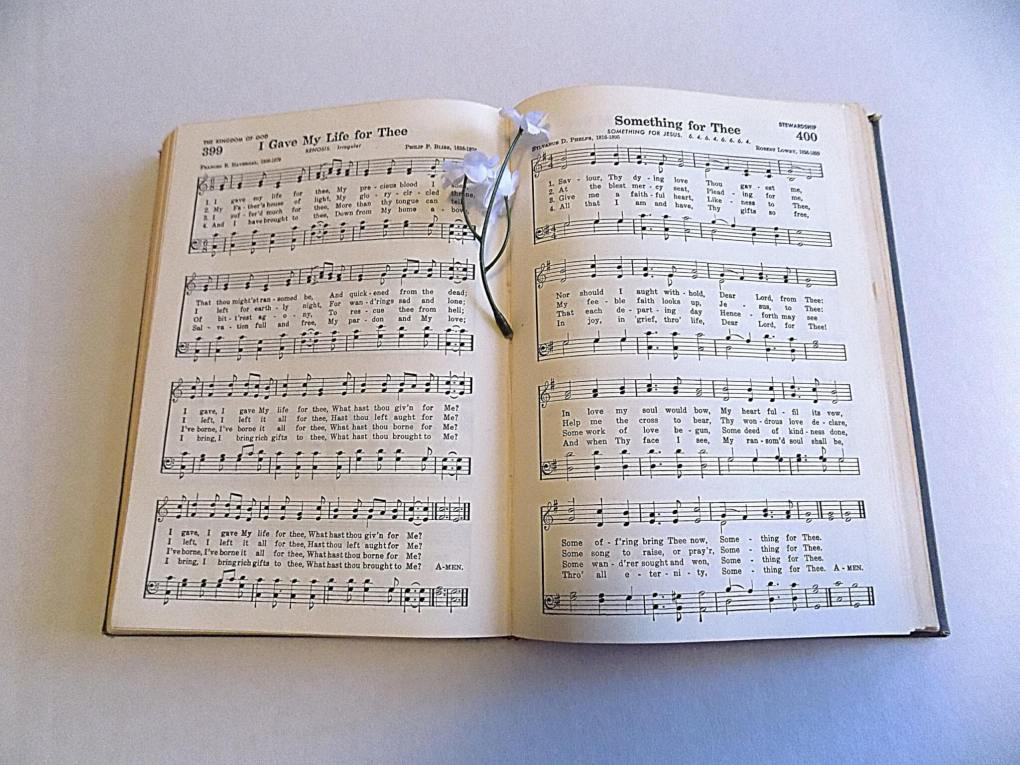Hymnbook with a sprig of white flowers