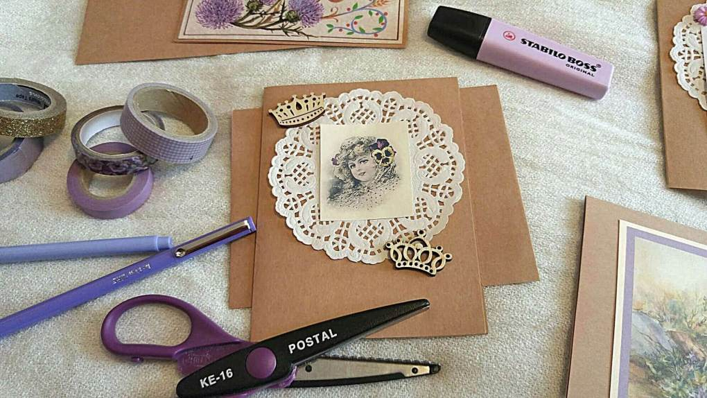 Picture of handmade card and card supplies such as washi tape, scissors, and pens