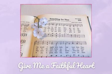 Picture of Hymnal open to Something For Thee with white flowers. The picture is on a background of lavender clouds and is labeled Give Me a Faithful Heart