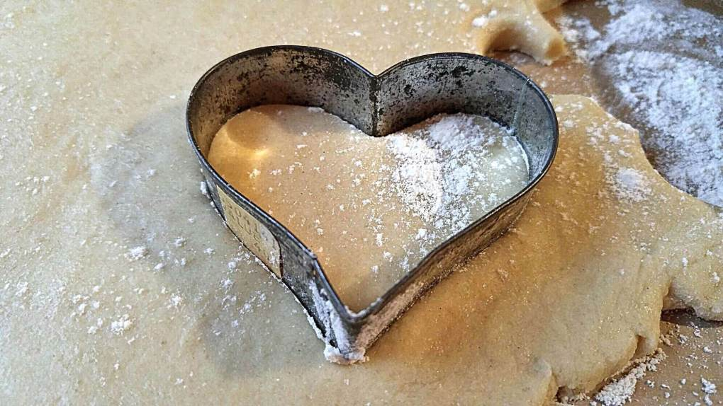 Heart shaped cookie cutter in cookie dough