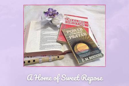An Hour of Hallowed Peace represented in picture by Bible, books on prayer, bamboo whistle, and purple flowers