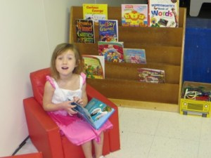 Girl reading books at preschool