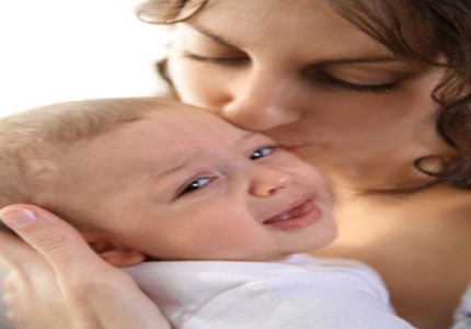 Crying baby is consoled by mother