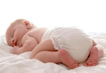 baby sleeping wearing disper