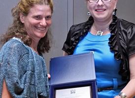 Dr. Marysia Galbraith, left, receives the Bronislaw Malinowski Social Sciences Award