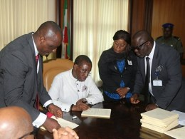 Okowa Signs DSIEC LAW