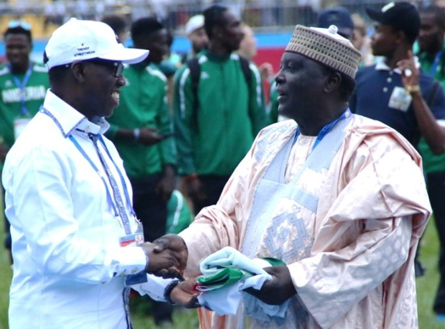 Delta State Governor, Senator Ifeanyi Okowa (left), Presenting the Hosting Flag to the President, Confederation of African Athletics, Hamad Kalkaba Malboum at the closing ceremony of the 21st African Senior Athletics Championship at the Stephen Keshi Stadium, Asaba